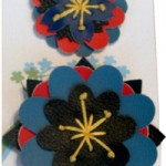 two-blue-black-flower-pins
